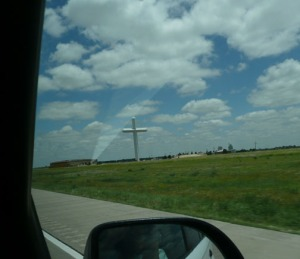 This is advertised as the largest cross in the northern hemisphere found south of Okalahoma City. (Anne Miller/image) Ray of light provided by God or another bug on the windshield.